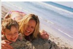 Single parent family on beach | mum and child